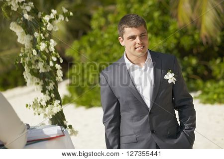 Handsome Groom Waiting For Bride During Ceremony On The Beach.