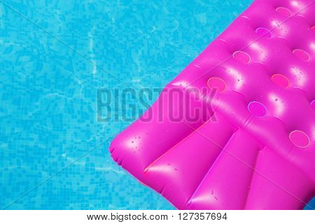 Pink air mattress in swimming pool. Holiday background. outdoors