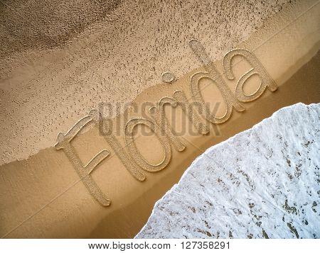Florida written on the beach