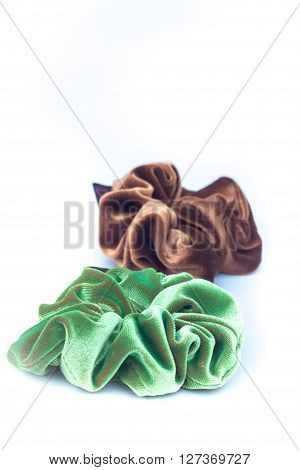 Hair rubber bands on white background, stock photo