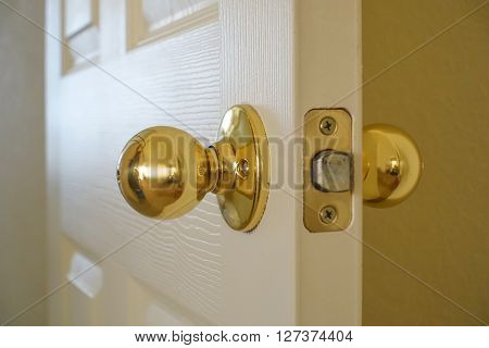 Close up view of an interior door and installed lockset.