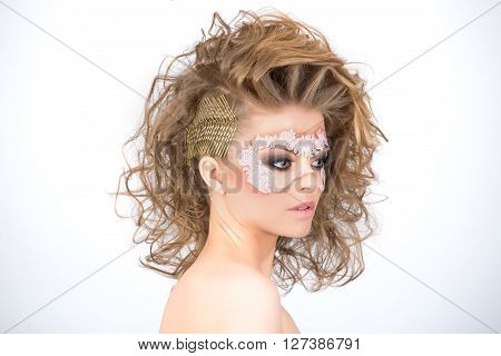 Fancy volumed hairstyle and artistic make up