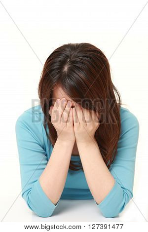 dportrait of epressed woman on white background