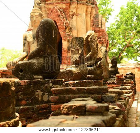 Ancient buddha statue at Mahathat temple, historic site in Ayuttaya province,Thailand.