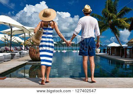 Couple near poolside jetty at Seychelles