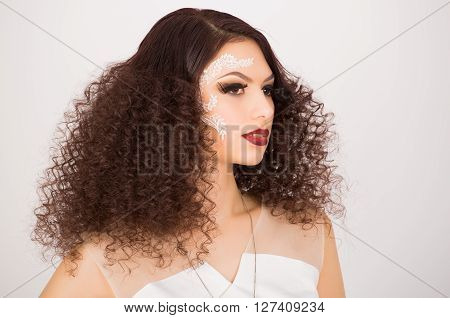 Portrait of girl with afro hairstyle and artistic make up