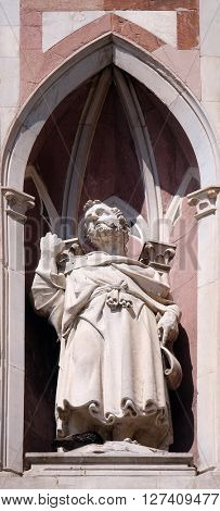 FLORENCE, ITALY - JUNE 05: The Bearded Prophet by Nanni di Bartolo, Campanile (Bell Tower) of Cattedrale di Santa Maria del Fiore, Florence, Italy on June 05, 2015