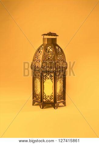 A colorful graphic design of a ramadan lantern. 'Ramadan Kareem' - A  graphic greeting card cover.