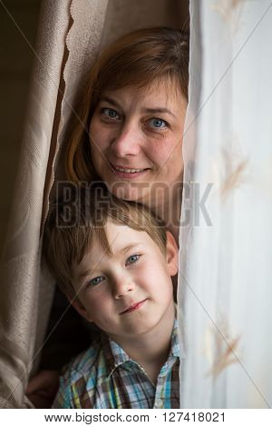 Closeup portrait of a mother with a young son.