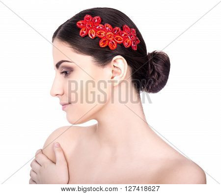 Side View Of Young Woman With Beautiful Accesory In Hair Isolated On White