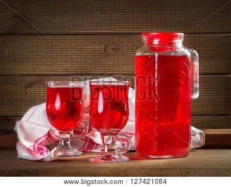 Jug and glasses with strawberry juice