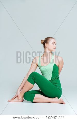 Beautiful woman doing stretching exercise isolated on a white background