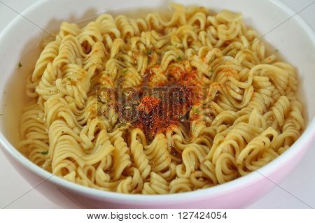 instant noodle parboiled in the white bowl