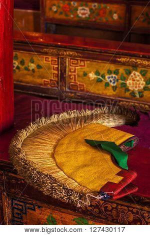 Yellow hat (attribute of  Gelug sect of Buddhism) in Likir Gompa (Tibetan Buddhist monastery). Ladakh, India