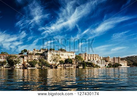 India luxury tourism concept background - Udaipur City Palace view from Lake Pichola. Udaipur, Rajasthan, India