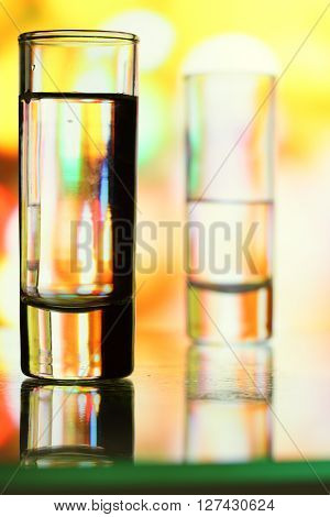 Glass of vodka on a bar counter