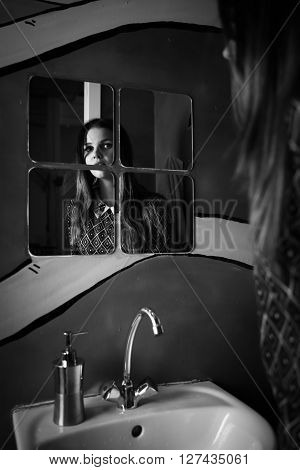 Black And White Photo Of A Woman Reflection In Mirror