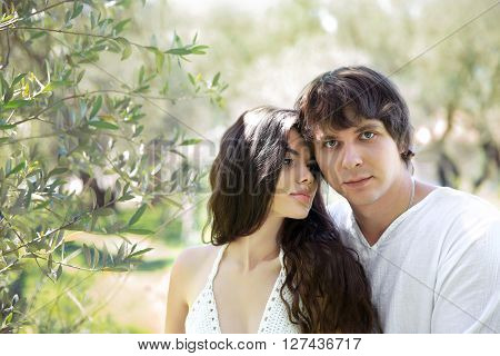 Romantic Young Couple Outdoor Portrait. Beautiful Sensual Brunette Woman Tempting Hansome Man In Gre