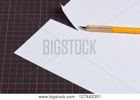 Utility Knife And Cut Paper