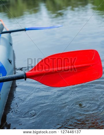 Red paddle for white water rafting and kayaking