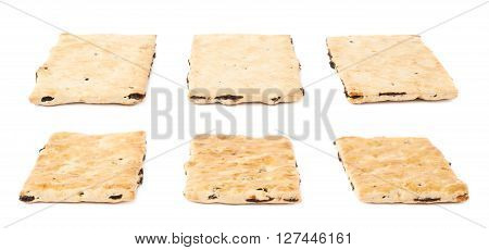 Three single raisin cracker cookies isolated over the white background, each in two different foreshortenings