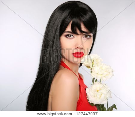 Hairstyle. Beauty Woman Face Portrait With Flowers. Healthy Long Black Hair. Red Lips. Beautiful Fas