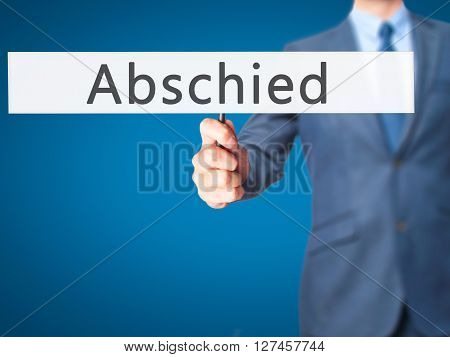 Abschied (farewell In German) - Businessman Hand Holding Sign