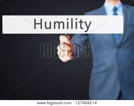 Humility - Businessman Hand Holding Sign