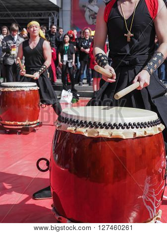 Moscow, Russia - April 24, 2016: Japaneses are performing Japanese percussion instruments taiko at Hinode Japanese Festival in Moscow.
