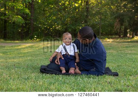 A father enjoying the outdoors with his baby son