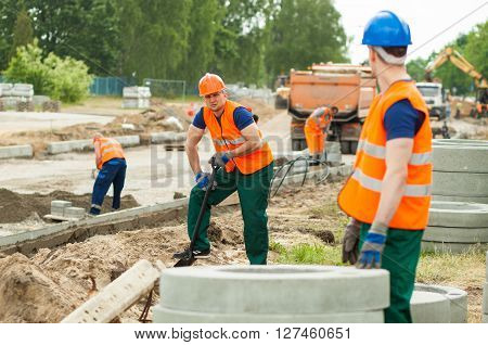 Manual Workers On Construction Site