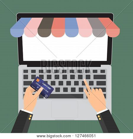 Hand holding credit card for paying in laptop notebook PC with copy space with shop online store. E-Commerce omnichannel online shopping concept.