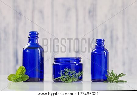 Various Aromatic essential oil  in blue bottles poster