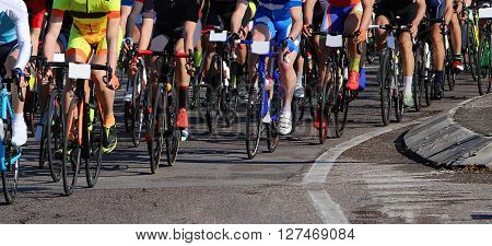 many cyclists with fast race bike during the cycling race on asphalt road