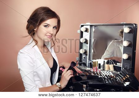 Beauty Makeup Artist Professional Stylist Holding Brushes In Dressing Drrom. Cosmetics. Attractive W