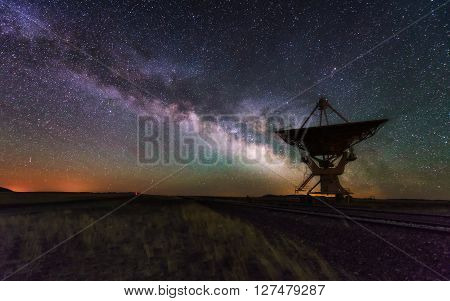 Milky way and big antenna dish at Very Large Array New Mexico USA. Powerful telescope for astronomy searching poster