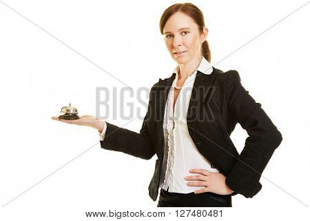 Concierge or bellhop with a hotel bell in her hand