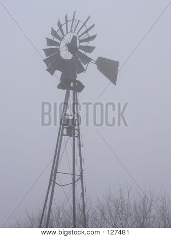 Old Windmill On A Foggy Winter Day