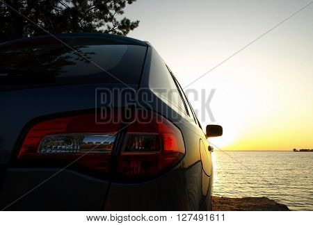 Car on the sand of sea beach at sunset stock photos