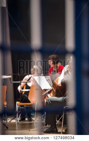 STRASBOURG FRANCE - MAR 18 2016: View through the window of a building at the classical music orchestra team preparing for the concert in Strasbourg France