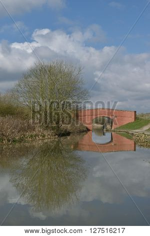 the reflection of a bridge and tree in the canal near Brimington England ** Note: Soft Focus at 100%, best at smaller sizes