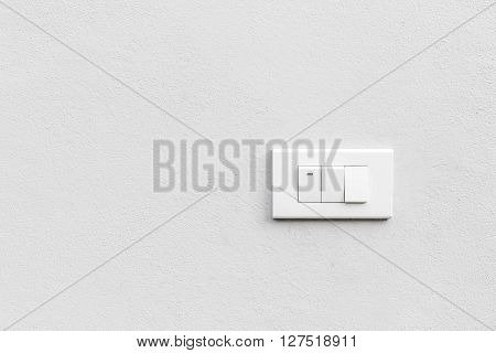 White light switches over white wall. Horizontal