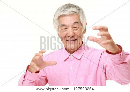 senior Japanese man with supernatural power on white background