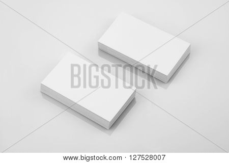 Blank Business Card Mockup on White Reflective Background