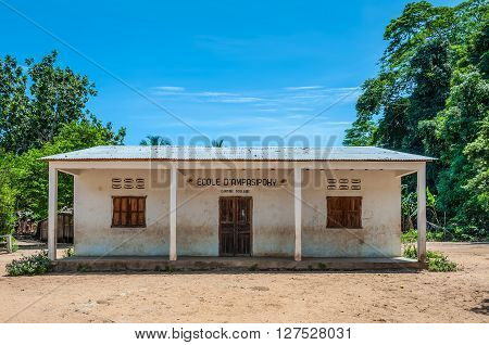 Ampasipohy Nosy Be Madagascar - December 19 2015: The school cantine and post office building in the village of the Ampasipohy Nosy Be Island Madagascar. Children on Christmas vacation.