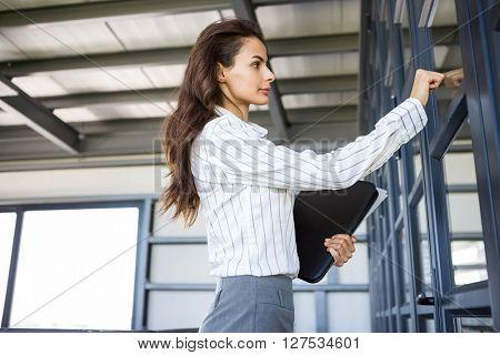 Businesswoman knocking on door in office