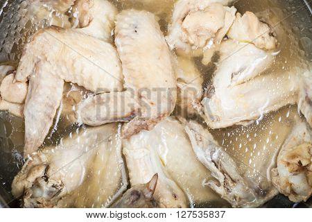 Boiled Chicken Wings In Greasy Bouillon In Stewpan