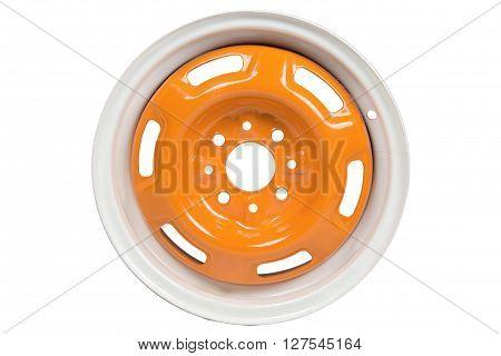 Powder coating of light orange wheel disk on white background