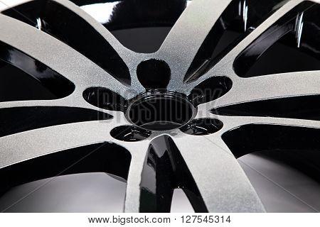 Powder coating of black wheel disk, close up