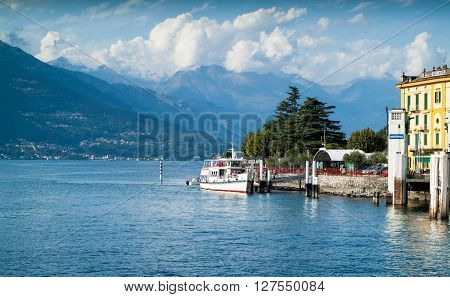 Varenna, Italy - September 4th 2015: people embarking on a white ferry in Varenna a resort town near Lake Como in North Italy.